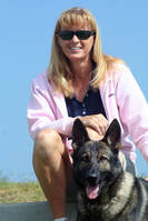 lady in pink jacket with german shepherd dog